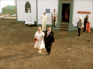 The couple walking out to their chariot.